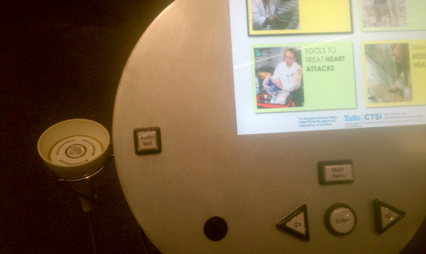 An image of the button interface at a Museum of Science single-user kiosk